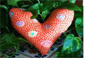 The Westside Quilters Guild makes heart- shaped pillows for recovering breast cancer patients.