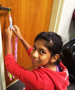 One young lady uses fabric scraps to help the elderly.